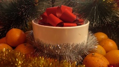 New Year. Christmas composition of tangerine, tree branches and gift Stock Footage