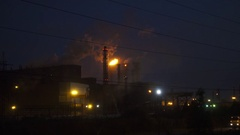 Emissions from chimneys of plant at night Stock Footage