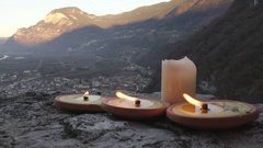 Burning Candles on Castle Wall at December Sunset Stock Footage