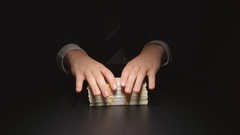 Bribe: Businessman hesitate puts down a heap money on a table Stock Footage