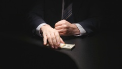 Bribe: Businessman takes a money bundle and puts in a suit at negotiation time Stock Footage