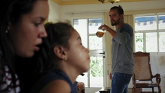 Family Problems With Father Drinking And Mother Crying With Daughter Stock Footage