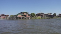 Stilted houses in village on famous Inle Lake Stock Footage
