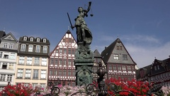 4K Famous Lady Justice statue in old town Frankfurt medieval architecture house Stock Footage