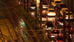 4K Aerial view crowded traffic car busy wet avenue Frankfurt city rainy night Stock Footage