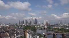 4K Zoom in Frankfurt modern skyline corporate business tower traffic vehicle day Stock Footage