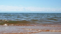 Surf on Lake Issyk-Kul in the background of mountains, beach town of Cholpon Stock Footage