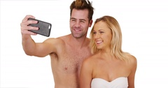 Young social media obsessed couple taking selfies to post online Stock Footage
