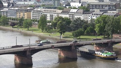 4K Aerial view Frankfurt city suburban area and cargo ship sail on river transit Stock Footage