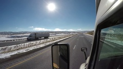 Editorial - Exterior Semi-Truck - UPS Truck Pass in Rural Wyoming Stock Footage
