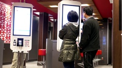 Motion of people ordering food at self check out machine at Mcdonalds Stock Footage
