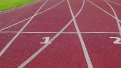 Athletics Stadium With Red Running Sport Track Closeup. Dolly Right Left Stock Footage