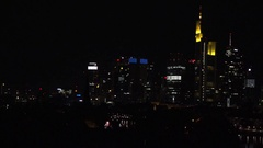 4K Pan right amazing Frankfurt town panorama by night modern skyscraper building Stock Footage