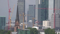 4K Aerial view modern skyscraper in Frankfurt crane machine construction site Stock Footage