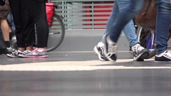 4K Closeup feet walking at rush hour in central train station people travel day Stock Footage