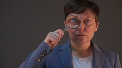 Businesswoman with magnifying glass, female tax inspector Stock Footage