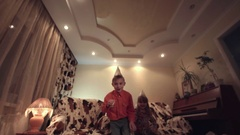 Kids with party hats making noise Stock Footage