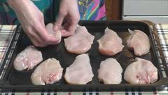 Woman prepares chicken Stock Footage