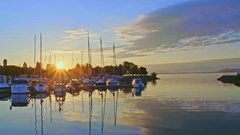 Yachts in sunset in Neuchatel, Switzerland Stock Footage