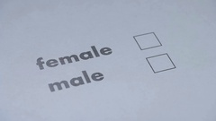 Filling the questionnaire, sex selection of male or female Stock Footage