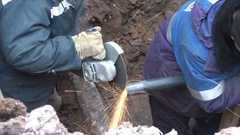 PERM, RUSSIA - Workers spend sidebar pipe to the gas pipeline Stock Footage