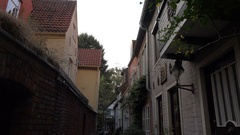 4k Small alley old buildings tilt down Bremen city famous streets area Schnoor Stock Footage