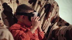 Boy looking through VR headset and gesticulating Stock Footage
