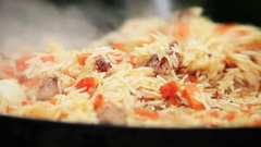 Traditional Uzbek (Middle Asia) dish is mixed during the preparation Stock Footage