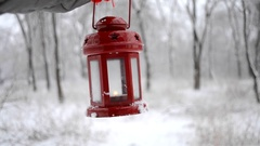 Holding a red candle lantern in the winter forest. Stock Footage