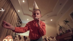 Little boy holding sparkler and blowing whistle Stock Footage