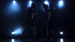 Two boxers are working to blows. Silhouette of young sportsmen Stock Footage