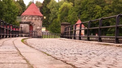 A man walks along the medieval dam in the old city in the Czech Republic Stock Footage