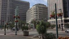 Pedestrians cross road, Orange Avenue, city hall, Orlando, Florida USA Stock Footage