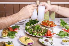 Lovely Couple Sitting, Drinking, Say Cheers, drinking Turkish Drink Raki, Ouzo Stock Photos