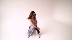 Young woman dancing against a white background at studio 4K Stock Footage