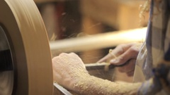 Foot operated spring pole wood lathe Stock Footage