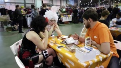 People playing table game at the Gamefilmexpo festival Stock Footage