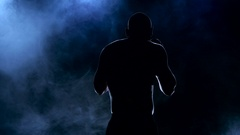 Silhouette boxer a dissecting the smoke blows Stock Footage