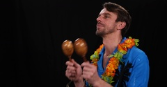 Hawaiian Music Young Man Playing Maracas Pair Shakers Tropical Exotic Latin Song Stock Footage