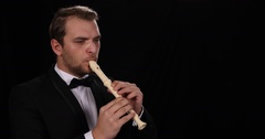 Young Musician Man Playing Recorder Flute Woodwind Instrument Orchestra Soloist Stock Footage