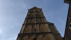 4k Bremen dome tower tilt down with musicians sculpture Turmbläserbrunnen Stock Footage