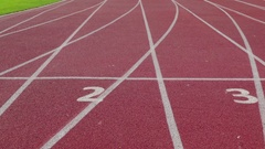 Athletics Stadium With Red Running Sport Track Closeup. Dolly Left Right Stock Footage