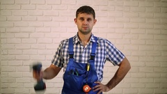 A man with a screwdriver.  Worker repairman, builder of the working suit. Stock Footage