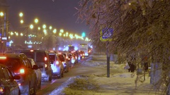 Cars stands in traffic jam because of the freezing rain Stock Footage