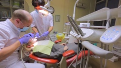Young woman is on the procedure of dental crown installation. Stock Footage