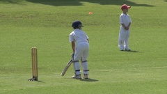 Junior Cricket - 8 Year old boys playing cricket game Stock Footage