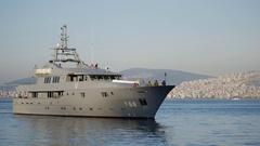 Turkish Navy Yakamoz Yacht sails into port Heybeliada. Stock Footage