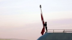 Turkish Naval Forces Raise the National Flag on a warship Stock Footage