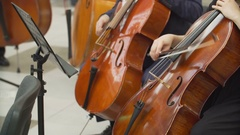 Hands of musicians playing the cello in the orchestra Stock Footage