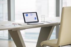 Laptop on a modern office desk Stock Photos